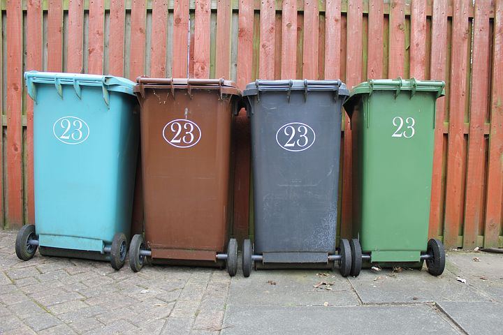 four garbage bins